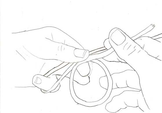 Step 4: Twist the tag end and circle it around to create a 3 inch diameter loop with about 3 inches sticking out.