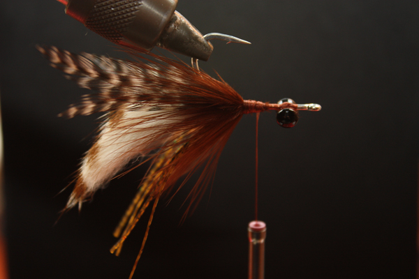 Step Four: Palmer marabou to hide rear wraps for a neat fly.