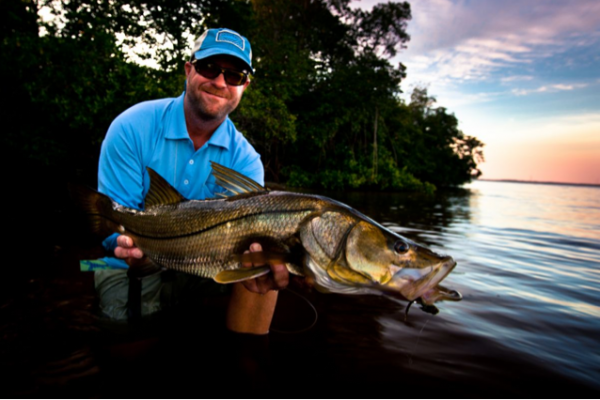 Captain Lowder with a bucket list snook that didn't get away.