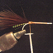 STEP #3 Tie in a clump of brown marabou at the end of the hook. TYING TIP Always coat the fly with Sally Hansen's hard as nails after each step.