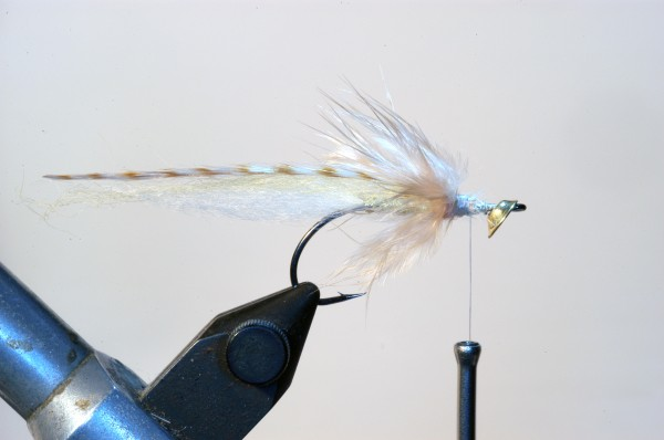 6.) Use the bottom part of that feather – the marabou part – to make a hackle. 1-2 turns only