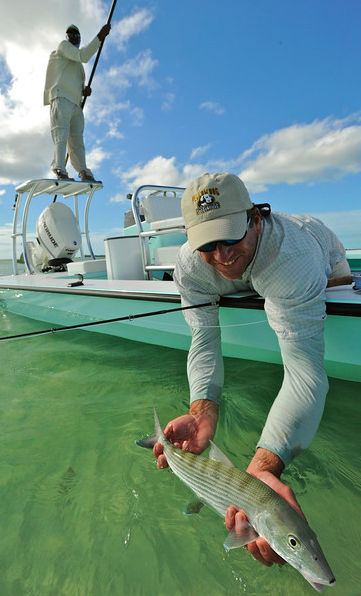 Tom Karrow releasing a nice Bahamas bone. Karrow photo in May, 2014.