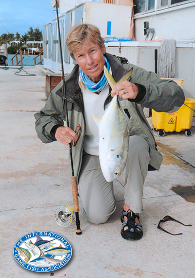 Ballantyne with her record crevalle, jack (3-pounds, 1-ounce) caught  on 2-pound test line in January of 2010, with legendary Key West  guide Capt. Robert Trosset (Minnow Fly). Photo courtesy of Fitz Coker.