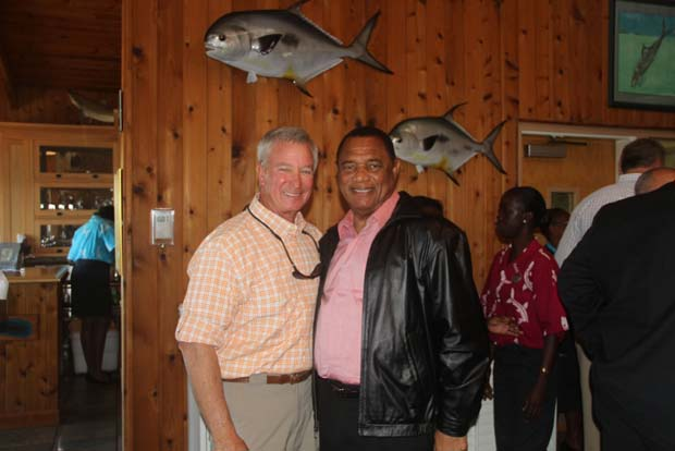 Harold Brewer, Bonefish & Tarpon Trust board member and Managing Director of the Bahamas (L), with Bahamas Prime Minister Perry Christie (R) during a meeting about conservation of the bonefish fishery at Deep Water Cay in 2013. BTT photo.