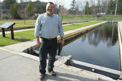 """Harrietta Hills Trout Farms co-owner Dan Vogler wants to produce up to 300,000 pounds of trout at the historic Grayling Fish Hatchery. Proposed trout farm near """"holy waters"""" of Au Sable River would be Michigan's biggest. Photo Lindsey Smith Michigan Radio (NPR)."""
