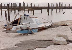 A storm surge during Hurricane Alicia combined with normal high tides to overcome this low-lying breakwater. The protected harbor then became an open bay and all of the boats in the harbor either sank or were carried ashore.