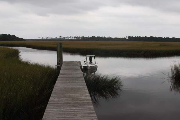 The Fish Camp dock, he Weed's dock and some fishy-looking marsh. In the distance is the Intracoastal Waterway - roughly marker 26. Boat traffic heading south all day.