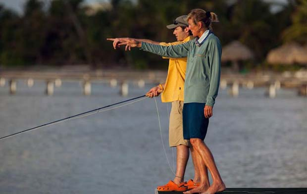Lori-Ann Murphy, Fishing Director at El Pescador Lodge in Belize passes on some angling advice to lodge guest.