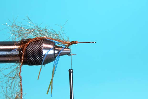Step 3: On top of the Fly Enhancer Legs, tie in Polar Chenille and wrap back to the bend of the hook.