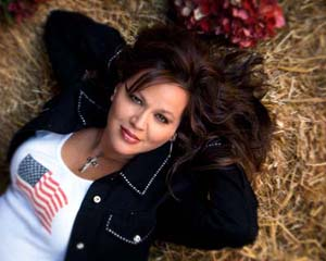 Lisa Mei Norton. Lisa is a retired Air Force Senior Master Sergeant turned political singer, songwriter and activist. She's had a passion for music her entire life, performing in bands and choirs at school, at church and in military clubs while stationed overseas.