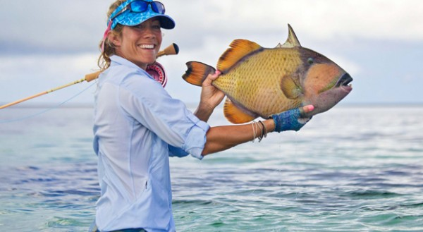 Carter with fly caught trigger fish in Cosmoledo. Photo by Joaquin Arocena.