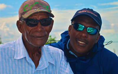 Prescott Smith with his famous father, Charlie Smith, inventor of the Crazy Charlie Fly. Prescott is the man behind the controversy and is the president of the Bahamas Fly Fishing Industry Association.
