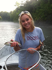 Liza Almand with nice Watauga River rainbow caught on July 3, 2012. Image credit www.altamontanglers.com.