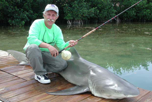 "Marty Arostegui, IGFA all-time record holder, with lemon shark caught with Captain Delph off Key West. href=""https://www.delphfishing.com/"" target=""_blank"">Contact Delph Fishing for your Key West shark adventure"