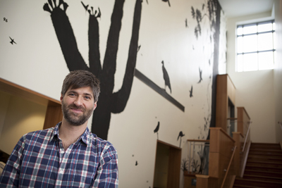 """Artist, writer, and naturalist James Prosek's """"Wall of Silhouettes"""" mural spans the full length of the north wall in the Cornell Lab of Ornithology's visitor center."""