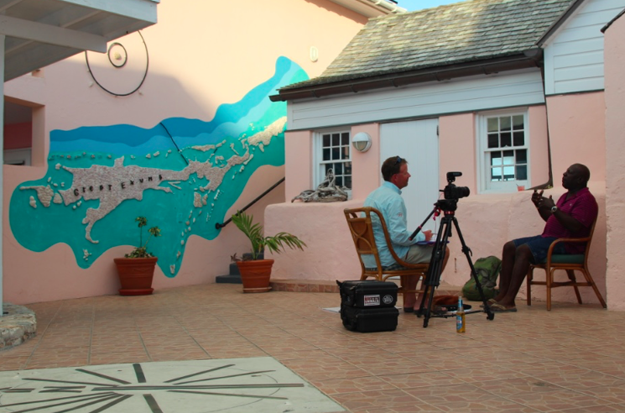 """Interviewing well-known Exuma guide """"JJ"""" Alan Dames at the Peace and Plenty Lodge in Georgetown. dan Decibel photo."""