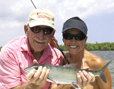 Bill with jean Eastman, a successful artist and dedicated angler. Here with a nice Biscayne Bay bone. A Pat Ford image.