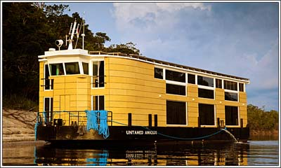 This doesn't look like Montana? Rio Maria Lodge anchored in the Amazon River in Brazil. A Rio Maria Lodge image.