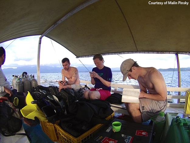 Rutgers University researchers Patrick Flanagan, Michelle Stuart, and Malin Pinsky (left to right) check equipment and prepare for a dive to study reef fish off the island of Leyte in the central Philippines in 2015. This research helps the team understand how fish populations go extinct and how they colonize new territory—key processes driving fish to cooler waters in North America and around the world.