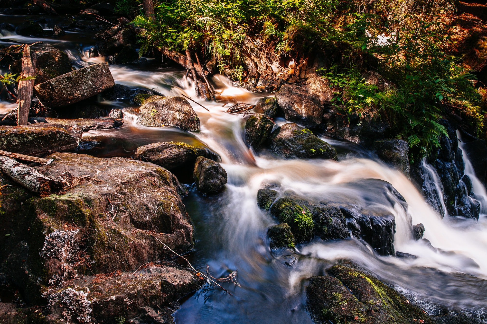 Fast river flowing water of waterfall in Finland