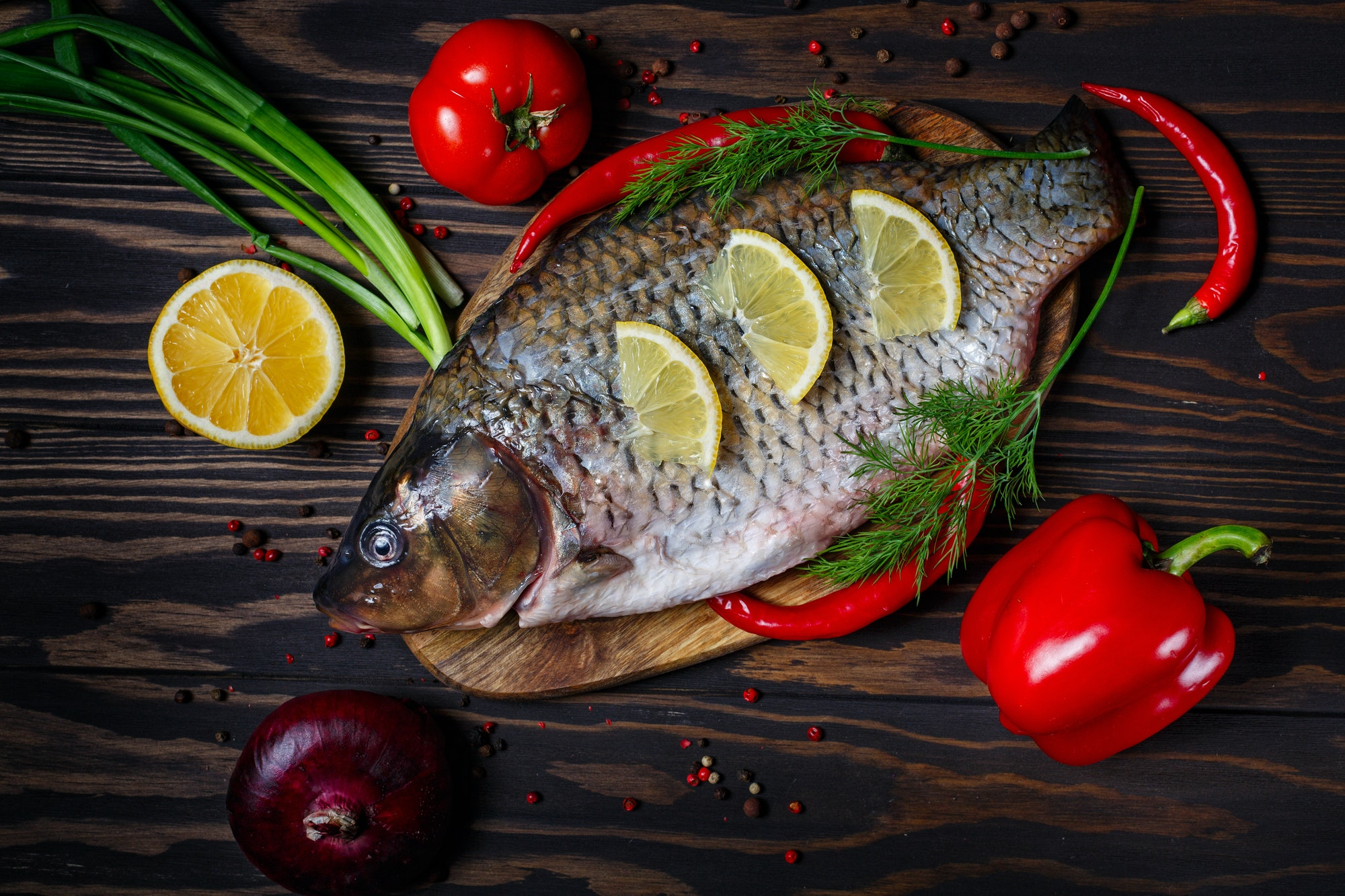Carp fish with fresh vegetables