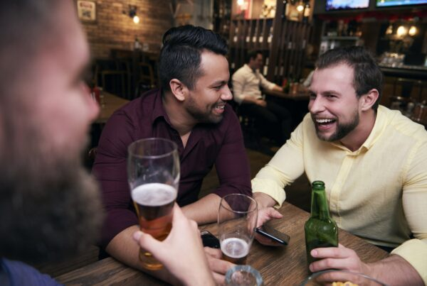Male friends chilling with drinks at the bar