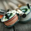 Fly fishing rod and reel on a wooden surface