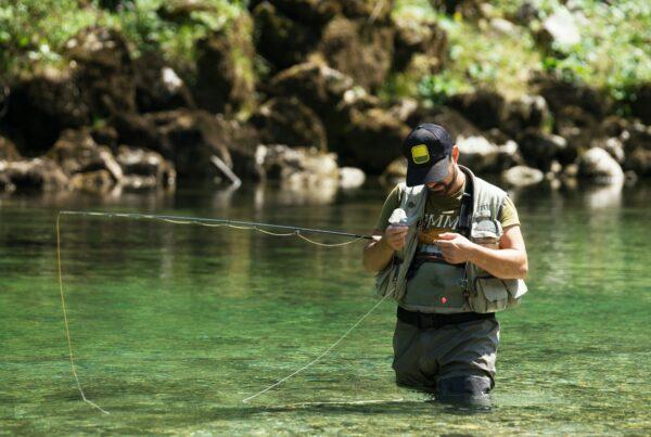 Fly fisherman flyfishing in river